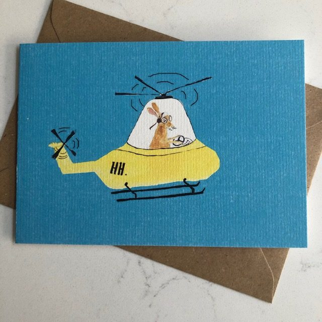 Greetings card of hare in helicopter