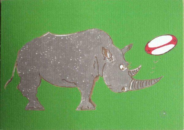 Rhino heading a rugby ball on a leaf green background