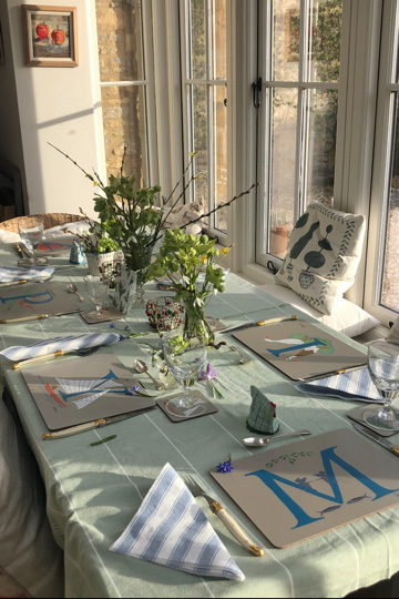 a table set with illustrated initials of each person present makes a fantastic family gift!
