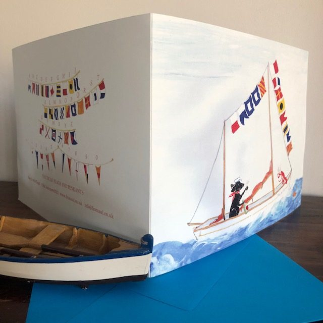 """A sailing boat dressed in nautical flags reading """"happy father's Day"""" or HAPPY BIRTHDAY, with an old seadog and his lobster cracking open the champagne."""